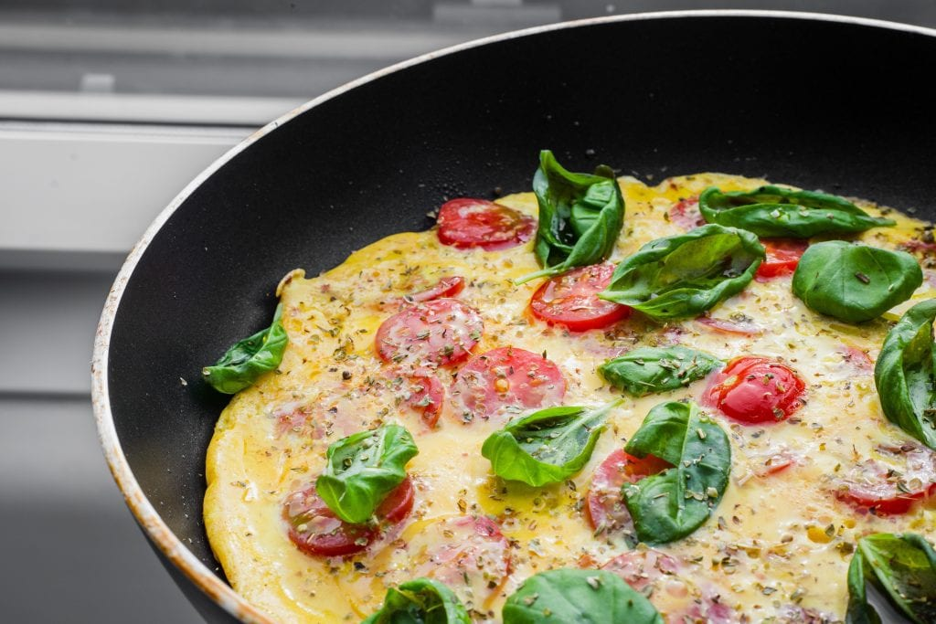 Omelet cooking in a non-stick pan.