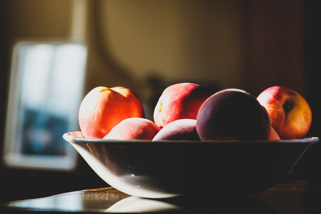 Peaches in a bowl.