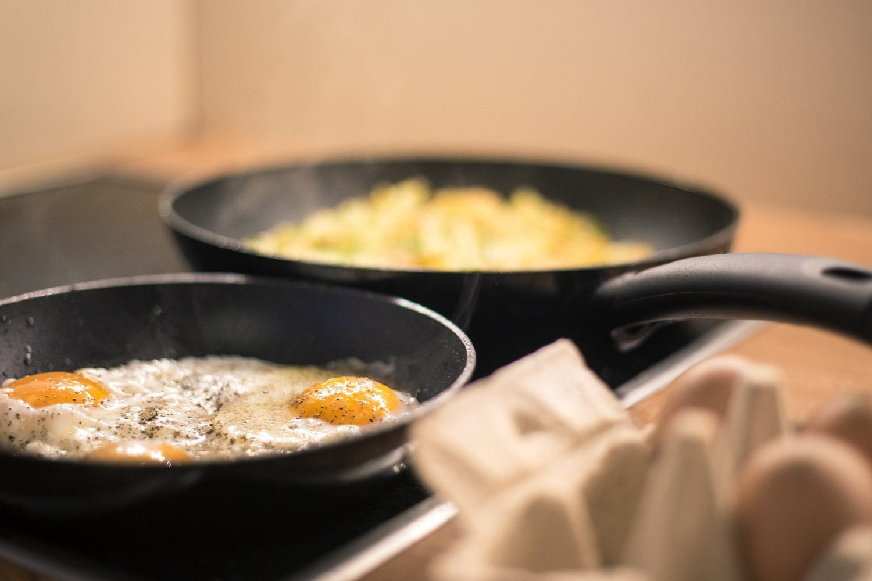Eggs cooking in nonstick pans.